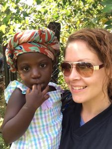 Ashley and her friend's little girl...just a small part of the beloved community she has found in Africa.